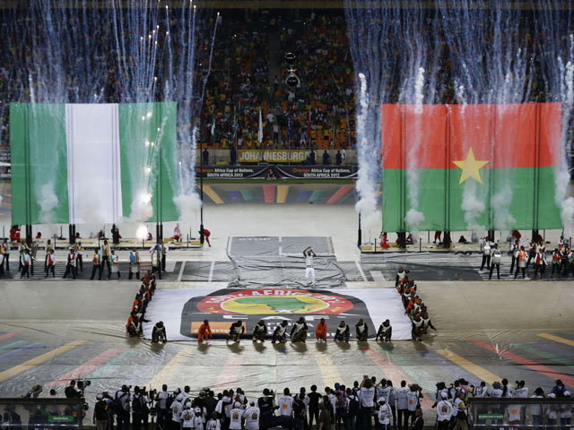 Flares go off next to the flags of Nigeria and Burkina Faso during the closing ceremony of the African Cup of Nations on February 10, 2013