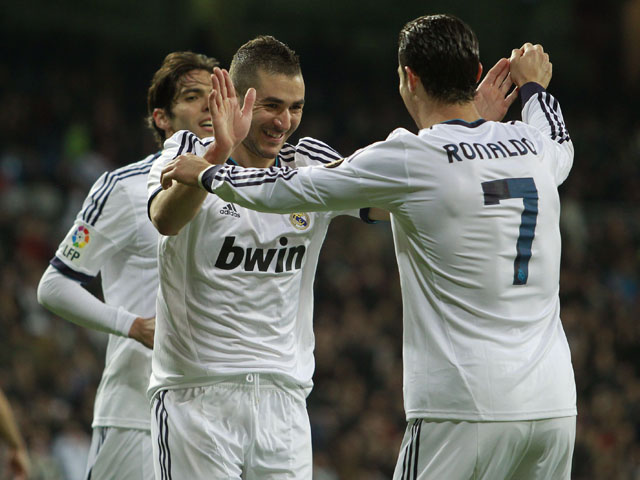 Real Madrid goalscorer Karim Benzema celebrates with teammates on February 9, 2013