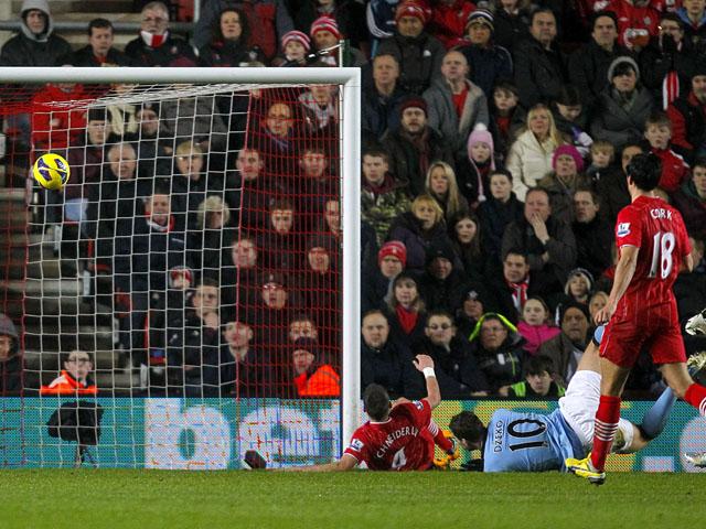 Manchester City forward Edin Dzeko scores against Southampton on February 9, 2013