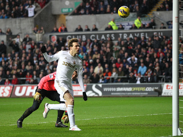 Swansea City forward Michu scores his side's first goal against QPR on February 9, 2013