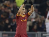 Roma's Erik Lamela celebrates a goal against Milan on December 22, 2012