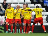 Watford's Ikechi Anya is congratulated by team mates after scoring his team's second against Birmingham on February 16, 2013