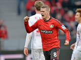 Leverkusen's Lars Bender celebrates scoring the his team's second against Augsburg on February 16, 2013