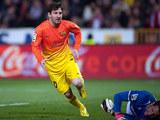 Barcelona's Lionel Messi celebrates his goal against Granada on February 16, 2013