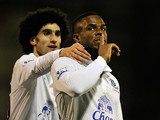 Everton's Victor Anichebe is congratulated by Marouane Fellaini after scoring the equaliser against Oldham in the FA Cup 5th round on February 16, 2013