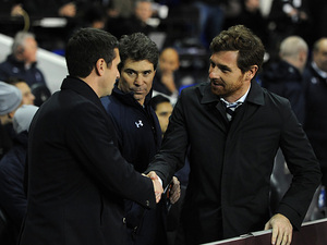 Tottenham Hotspur boss Andre Villas-Boas shakes hands with Lyon boss Remi Garde before kick-off on February 14, 2013
