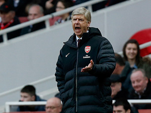 Arsenal boss Arsene Wenger shouts from the touchline during the FA Cup 5th round against Blackburn Rovers on February 16, 2013