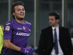 Fiorentina's Adem Ljajic celebrates after scoring against Inter Milan on February 17, 2013