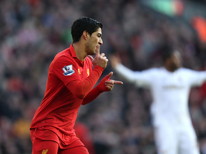 Luis Suarez celebrates scoring his team's fourth against Swansea on February 17, 2013