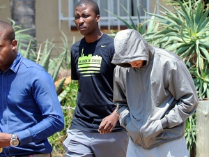 South African athlete Oscar Pistorius leaves the police station following his arrest for murder on February 14, 2013
