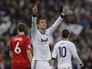 Real Madrid's Cristiano Ronaldo celebrates after scoring against Manchester United on February 13, 2013