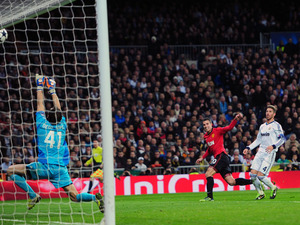 Manchester United striker Robin van Persie has his shoot tipped onto the bar on February 13, 2013