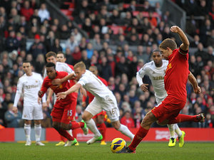 Steven Gerrard steps up to score a penalty to put his team a goal ahead against Swansea on February 17, 2013