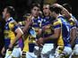 Leeds Rhinos' Joel Moon is congratulated by teammates after a try against Salford City Reds on February 15, 2013