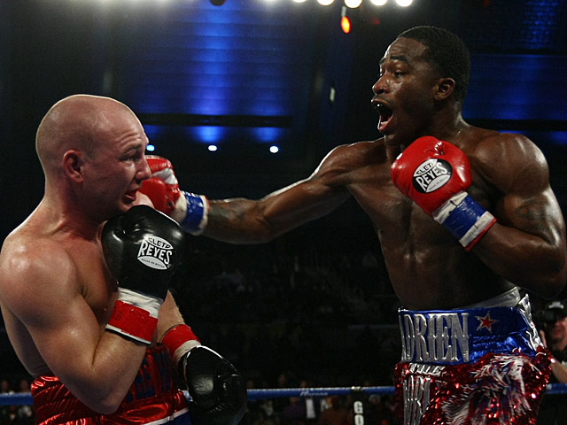 Adrien Broner throws a punch at Gavin Rees during their WBC lightweight title match on February 17, 2013