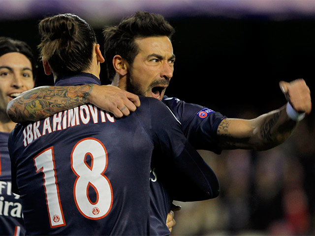 Paris Saint-Germain's Ezequiel Lavezzi is congratuated by team mate Zlatan Ibrahimovic after scoring the opening goal on February 12, 2013