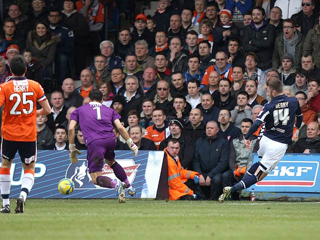 Millwall's James Henry scores the opening goal in the FA Cup 5th round tie against Luton on February 16, 2013