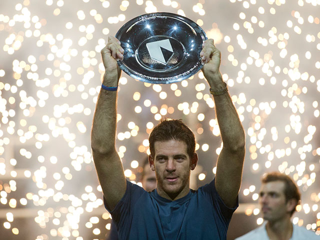 Juan Martin del Potro with the trophy after beating Julien Benneteau to win the ATP World Tour 500 indoor title in Rotterdam on February 17, 2013