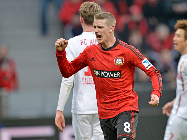 Leverkusen's Lars Bender celebrates scoring the his team's second against Augsburg on February 16, 2013