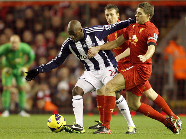 West Bromwich Albion's Youssouf Mulumbu and Liverpool's Steven Gerrard battle for the ball during their side's match on February 11, 2013