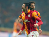 Galatasaray's Burak Yilmaz celebrates scoring for his team against Shalke on February 20, 2013