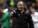 Levante coach Juan Ignacio Martinez gestures on the sideline during his side's game against Hannover on December 6, 2012