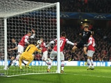 Bayern's Thomas Muller scores the second against Arsenal on February 19, 2013