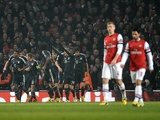 Bayern players celebrate after Toni Kroos gives them a 1-0 lead over Arsenal on February 19, 2013