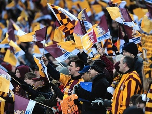 Bradford fans continue their support, with their team losing 4-0 to Swansea on February 24, 2013