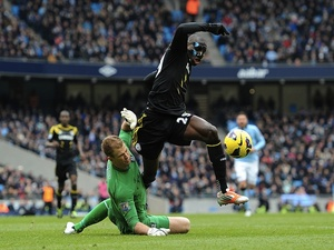 Chelsea striker Demba Ba is fouled by Joe Hart, winning a penalty in the game on February 24, 2013
