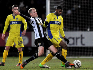 Notts County's Neal Bishop and Bury's Ethan Ebanks-Landell battle for the ball on February 22, 2013