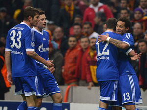 Shalke players celebrate with Jermaine Jones after he scored against Galatasaray in the Champions League on February 20, 2013