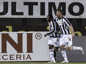 Siena's Innocent Emenghara celebrates a goal against Lazio on February 18, 2013