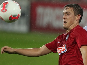 Freiburg's Max Kruse in action against Bayern Munich on November 28, 2012