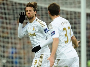 Swansea's Michu celebrates his goal against Bradford with Ben Davies on February 24, 2013