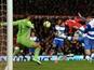 United striker Javier Hernandez heads the second goal against Reading on February 18, 2013