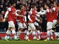 Arsenal players congratulate Santi Cazorla after a goal against Aston Villa on February 23, 2013