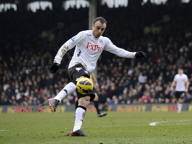 Fulham forward Dimitar Berbatov scores against Stoke on February 23, 2013