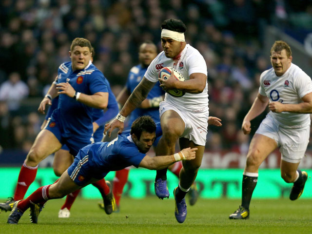 England's Manu Tuilagi is tackled by France's Morgan Parra during the RBS Six Nations match on February 23, 2013