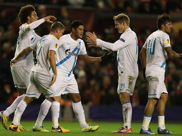 Zenit St Petersburg's Hulk is congratulated by team mates after scoring the opening goal against Liverpool on February 21, 2013