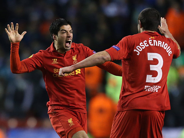 Liverpool's Luis Suarez celebrates with team mate Jose Enrique after scoring his team's third against Zenit St Petersburg on February 21, 2013