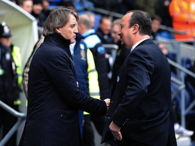 Opposing bosses Roberto Mancini and Rafa Benitez shake hands before the Man City v Chelsea match on February 24, 2013