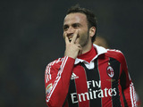 AC Milan forward Giampaolo Pazzini celebrates scoring his second goal against Lazio on March 2, 2013