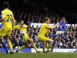 Everton's Steven Pienaar scores his side's second goal against Reading on March 2, 2013