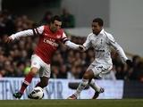 Arsenal's Santi Cazorla takes on Aaron Lennon of Spurs on March 3, 2013