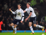Gareth Bale celebrates scoring Tottenham's winning goal against West Ham United on February 25, 2013