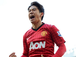 Manchester United's Shinji Kagawa celebrates scoring his third goal against Norwich on March 2, 2013
