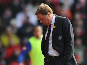 QPR manager Harry Redknapp looks dejected on the sidelines during his side's match against QPR on March 2, 2013