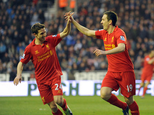 Liverpool's Stewart Downing celebrates with teammate Joe Allen after scoring against Wigan on March 2, 2013