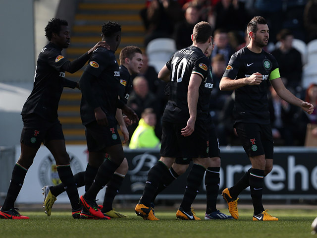 Celtic's Joe Ledley is congratulated by team mates after scoring the opener in the Scottish Cup quarter final against St Mirren on March 2, 2013